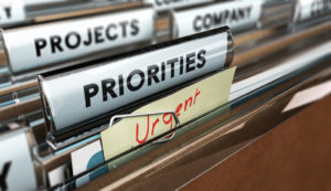 Close up on a file tab with the word Priorities with blur effect. Concept image for illustration of setting priorities in projects.